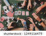 young friends playing poker on... | Shutterstock . vector #1249116475