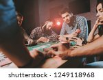 young friends playing poker on...   Shutterstock . vector #1249118968
