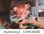 young friends playing poker on... | Shutterstock . vector #1249120282