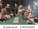 young friends playing poker on... | Shutterstock . vector #1249124062