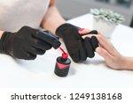 beautiful girl manicurist doing ... | Shutterstock . vector #1249138168