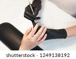 female manicurist cleaning... | Shutterstock . vector #1249138192