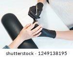 female manicurist cleaning... | Shutterstock . vector #1249138195