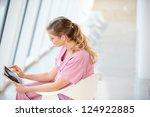 Female Nurse Sitting In Chair...
