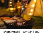 family making barbecue in... | Shutterstock . vector #1249346182