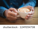 man hands holding a cup of...   Shutterstock . vector #1249354738