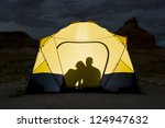 shadow of couple sitting in tent | Shutterstock . vector #124947632