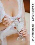 in women's hands dessert spoon... | Shutterstock . vector #1249485955