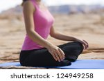 body of young woman meditating...   Shutterstock . vector #124949258