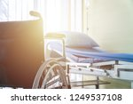 empty wheelchair and hospital... | Shutterstock . vector #1249537108