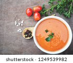 tomato soup on wood background   Shutterstock . vector #1249539982