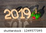 wooden figures 2019 on a wooden ... | Shutterstock . vector #1249577395