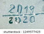 the inscription 2019 and 2020... | Shutterstock . vector #1249577425