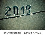 2019 inscription on the glass... | Shutterstock . vector #1249577428