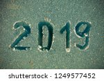2019 inscription on the glass... | Shutterstock . vector #1249577452