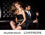 sexy elegant couple. beautiful... | Shutterstock . vector #1249598398