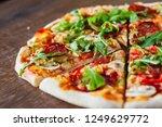 pizza with mozzarella cheese ... | Shutterstock . vector #1249629772
