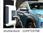 electric vehicle charging in... | Shutterstock . vector #1249723708