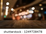 empty dark wooden table in... | Shutterstock . vector #1249728478