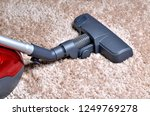 vacuum cleaner on shaggy carpet ... | Shutterstock . vector #1249769278