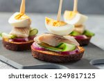 Stock photo tradition danish open sandwich smorrebrod with herring egg cucumber and onions dark bread 1249817125