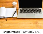 laptop computer pencil cup of... | Shutterstock . vector #1249869478