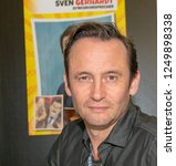Small photo of DORTMUND, GERMANY - December 1st 2018: Sven Gerhardt (*1968, german actor and voice actor) at German Comic Con Dortmund, a two day fan convention