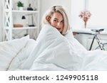 feeling cozy. attractive young... | Shutterstock . vector #1249905118
