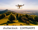 copter drone flying at sunset...   Shutterstock . vector #1249964095