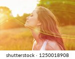 young woman on field under... | Shutterstock . vector #1250018908