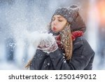 winter young woman portrait.... | Shutterstock . vector #1250149012