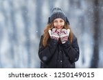 winter young woman portrait.... | Shutterstock . vector #1250149015