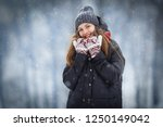 winter young woman portrait.... | Shutterstock . vector #1250149042