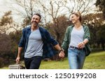 happy couple walking in the... | Shutterstock . vector #1250199208