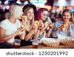 female friends eating and... | Shutterstock . vector #1250201992
