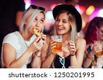 female friends eating and... | Shutterstock . vector #1250201995