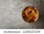 golden whiskey in glass with... | Shutterstock . vector #1250227255