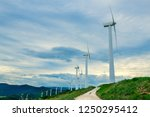 wind turbines. wind generators. ... | Shutterstock . vector #1250295412