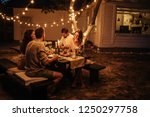 group of friends enjoying food... | Shutterstock . vector #1250297758