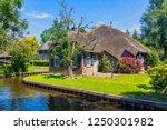 giethoorn  netherlands   july 4 ... | Shutterstock . vector #1250301982