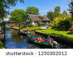 giethoorn  netherlands   july 4 ... | Shutterstock . vector #1250302012