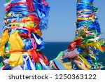 wooden posts covered in ribbons ... | Shutterstock . vector #1250363122