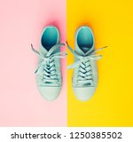new blue sneakers on yellow... | Shutterstock . vector #1250385502