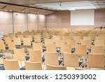 view of empty wooden seats in a ... | Shutterstock . vector #1250393002