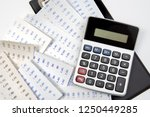 top view of calculator on... | Shutterstock . vector #1250449285