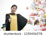 young girl graduated with a... | Shutterstock . vector #1250456578