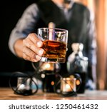 whiskey  in a glass.out of... | Shutterstock . vector #1250461432