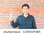 asian man holding trowel and... | Shutterstock . vector #1250529385
