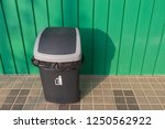 trash black wooden fence and...   Shutterstock . vector #1250562922