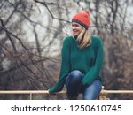 happy woman at wintertime.  | Shutterstock . vector #1250610745